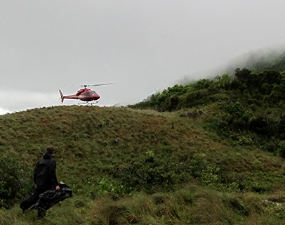 Helicopter landing at campsite on Tête Boeuf